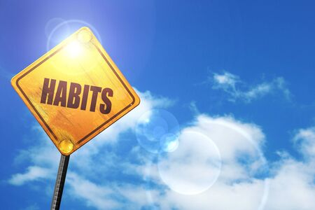 habits: yellow road sign with a blue sky and white clouds