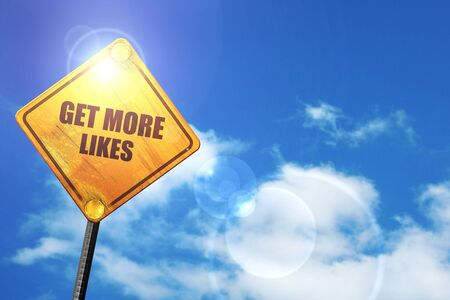 likes: get more likes: yellow road sign with a blue sky and white clouds