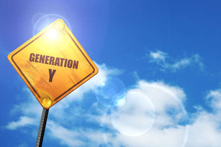 generation y: generation y word: yellow road sign with a blue sky and white clouds Stock Photo