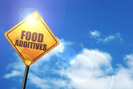 stabilizers: food additives: yellow road sign with a blue sky and white clouds