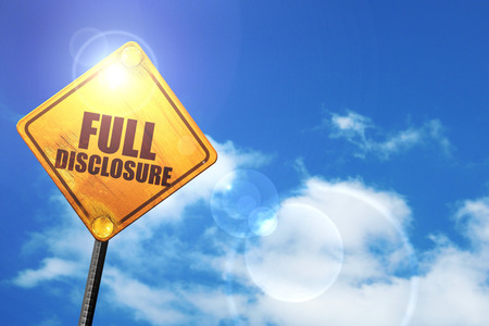 disclosure: full disclosure: yellow road sign with a blue sky and white clouds Stock Photo