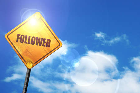 follower: follower: yellow road sign with a blue sky and white clouds