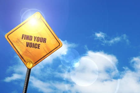 self discovery: find your voice: yellow road sign with a blue sky and white clouds