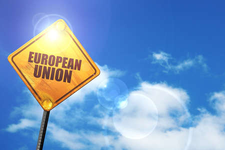 euro screw: european union: yellow road sign with a blue sky and white clouds Stock Photo