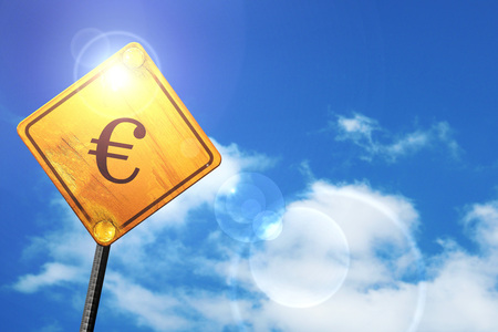 euro screw: euro sign: yellow road sign with a blue sky and white clouds Stock Photo
