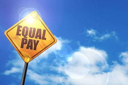 salarios: igualdad de retribución: cartel amarillo con un cielo azul y nubes blancas Foto de archivo
