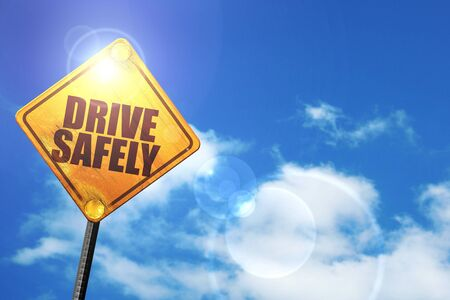 drive safely: drive safely: yellow road sign with a blue sky and white clouds