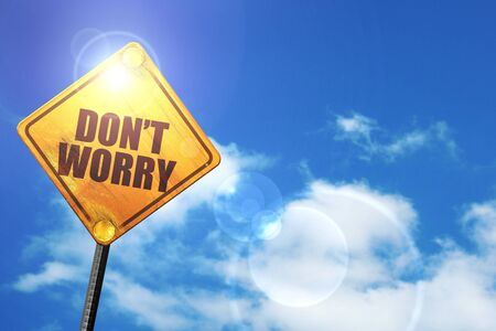 dont worry: dont worry: yellow road sign with a blue sky and white clouds Stock Photo
