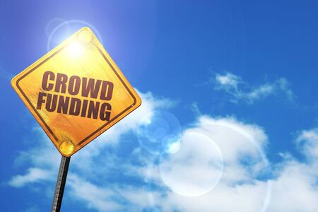 action fund: crowd funding: yellow road sign with a blue sky and white clouds