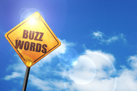 buzzword: buzzword: yellow road sign with a blue sky and white clouds