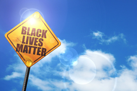 incarceration: black lives matter: yellow road sign with a blue sky and white clouds Stock Photo
