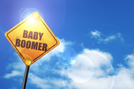 baby boomer: baby boomer: yellow road sign with a blue sky and white clouds Stock Photo