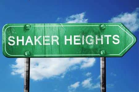 in the heights: shaker heights road sign on a blue sky background Stock Photo