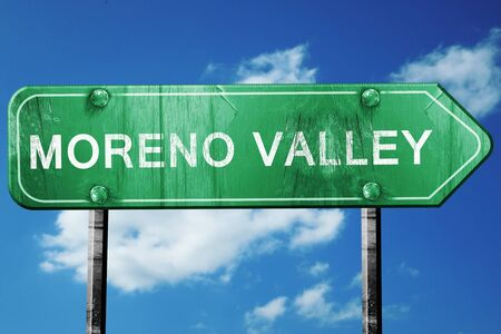 valley: moreno valley road sign on a blue sky background Stock Photo