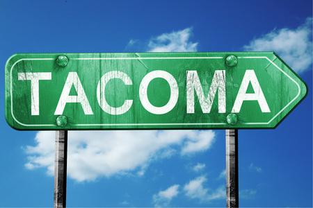 tacoma: tacoma road sign on a blue sky background