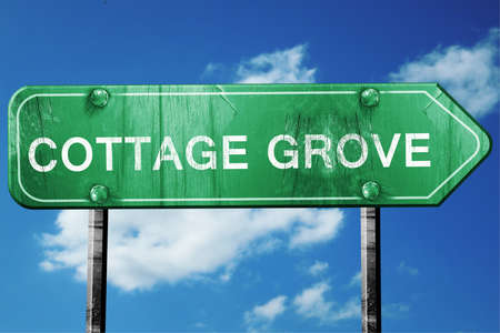 grove: cottage grove road sign on a blue sky background Stock Photo