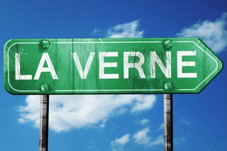 la: la verne road sign on a blue sky background
