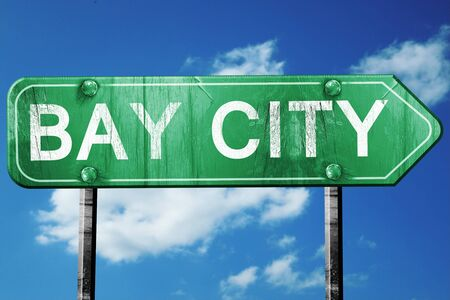 bay: bay city road sign on a blue sky background