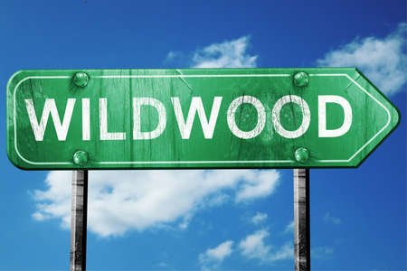 wildwood: wildwood road sign on a blue sky background Stock Photo