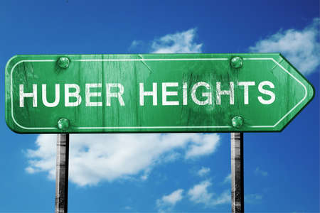 heights: huber heights road sign on a blue sky background