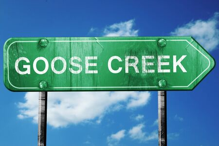 creek: goose creek road sign on a blue sky background Stock Photo