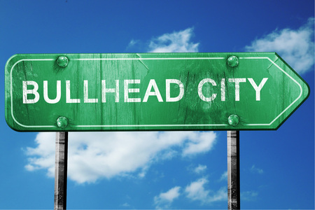 bullhead: bullhead city road sign on a blue sky background