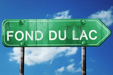 fond: fond du lac road sign on a blue sky background