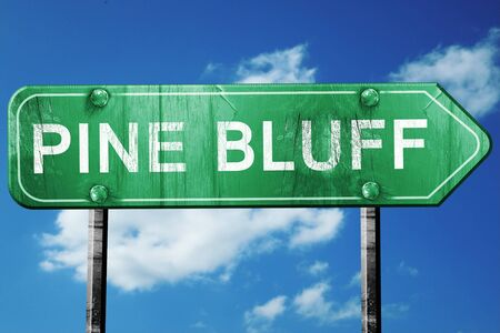 bluff: pine bluff road sign on a blue sky background