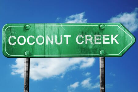 creek: coconut creek road sign on a blue sky background