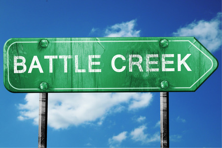 creek: battle creek road sign on a blue sky background Stock Photo
