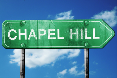 chapel: chapel hill road sign on a blue sky background