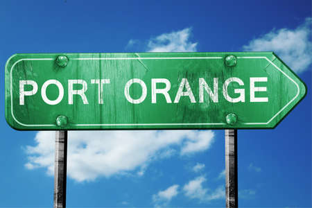 port: port orange road sign on a blue sky background Stock Photo