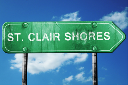shores: st. clair shores road sign on a blue sky background