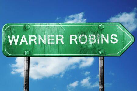 warner: warner robins road sign on a blue sky background