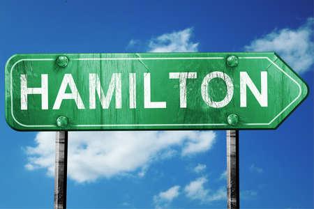 hamilton: hamilton road sign on a blue sky background