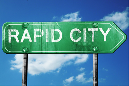 rapid: rapid city road sign on a blue sky background Stock Photo