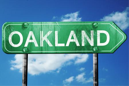 oakland: oakland road sign on a blue sky background