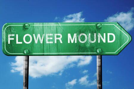 mounds: flower mound road sign on a blue sky background