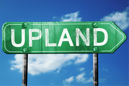 upland road sign on a blue sky background Stock Photo