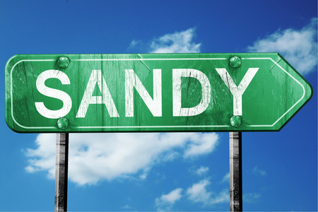 sandy: sandy road sign on a blue sky background