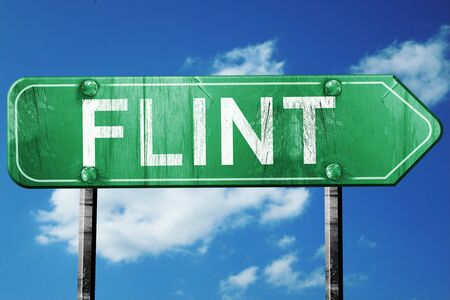 flint: flint road sign on a blue sky background