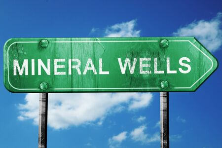 wells: mineral wells road sign on a blue sky background Stock Photo