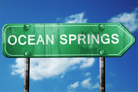 springs: ocean springs road sign on a blue sky background