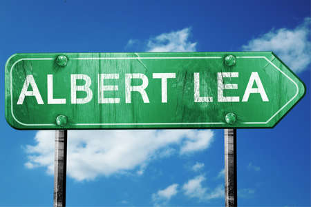 lea: albert lea road sign on a blue sky background
