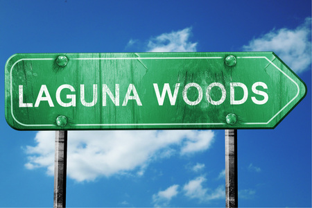 laguna: laguna woods road sign on a blue sky background