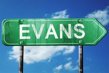evans: evans road sign on a blue sky background