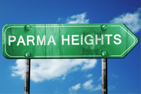heights: parma heights road sign on a blue sky background Stock Photo