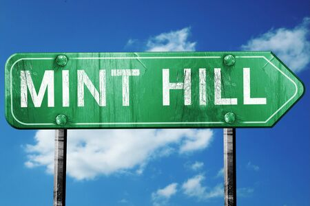mint: mint hill road sign on a blue sky background Stock Photo