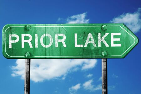 prior: prior lake road sign on a blue sky background Stock Photo