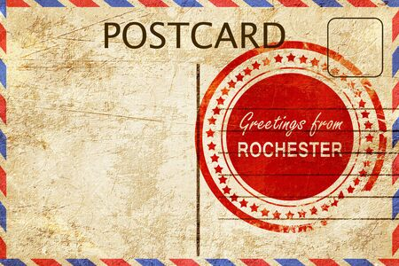 stamped: greetings from rochester, stamped on a postcard